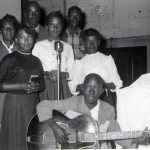 Clarence Wills (holding guitar) as budding band leader