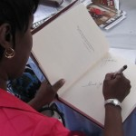 Cheryl signing limited edition coffee table books at Baltimore Book Festival